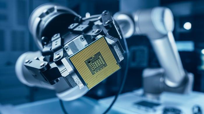 Robotic arm holding up a CPU.