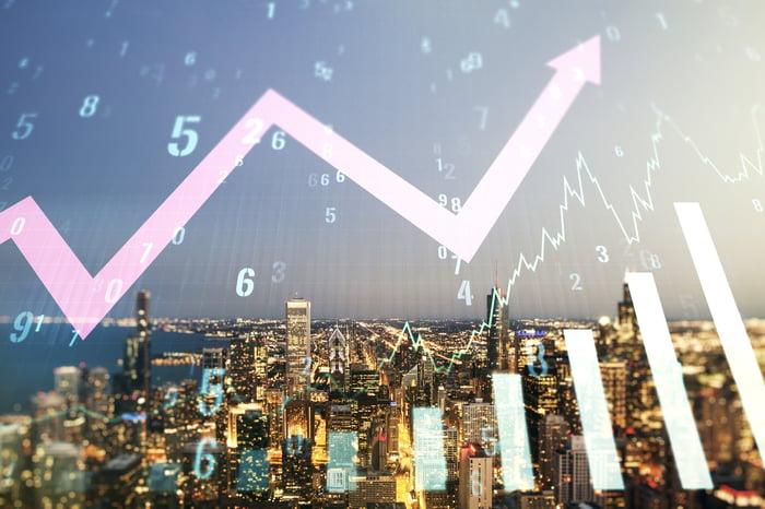 City skyline with upward stock chart.
