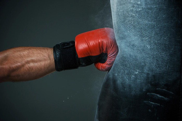 First with boxing glove hitting bag.