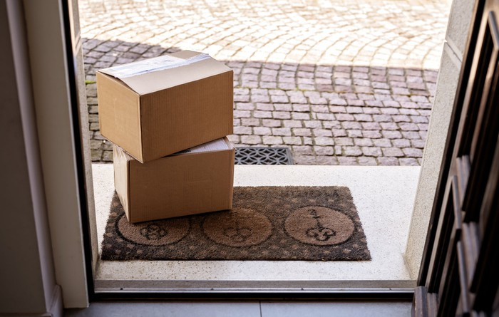 Two packages on a doorstep.
