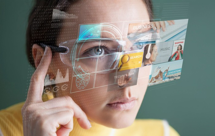A woman uses a pair of AR glasses.