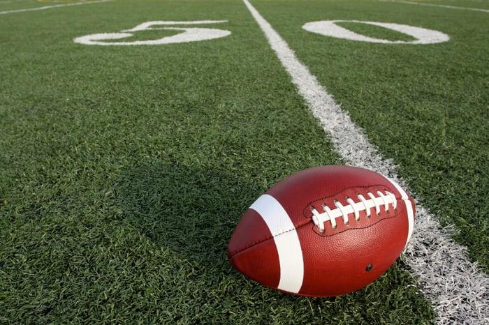 Football on the 50 yard line.