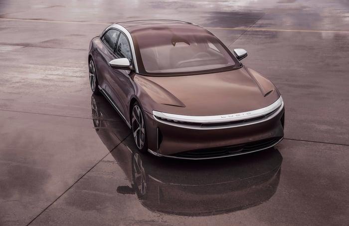 A brown Lucid Air, a sleek electric luxury sports sedan.