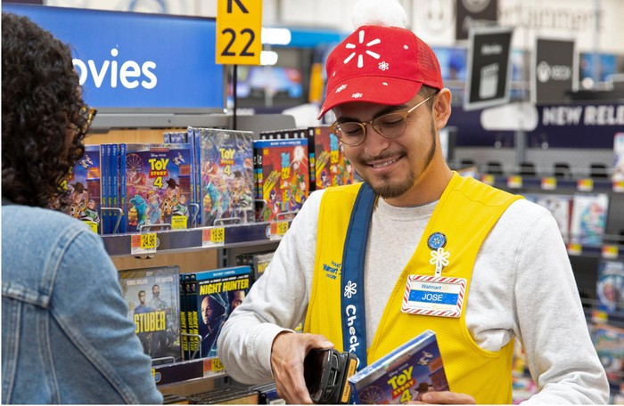 A Walmart employee scanning a product.