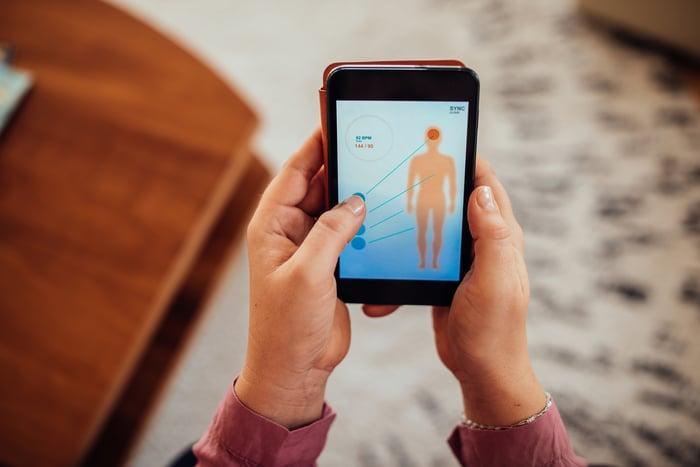 Smartphone user utilizing a medical diagnostic app.