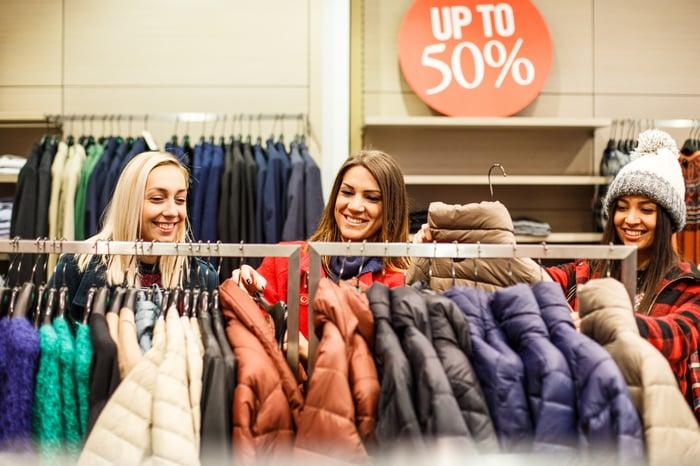 Three women shopping for coats.