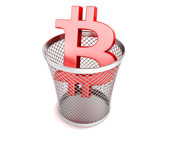 Red Bitcoin symbol in a trash can.