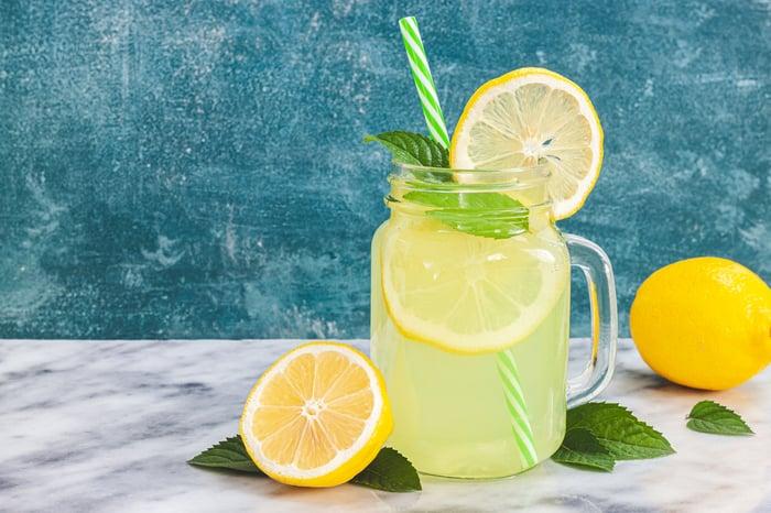 Jar of lemonade with a straw.