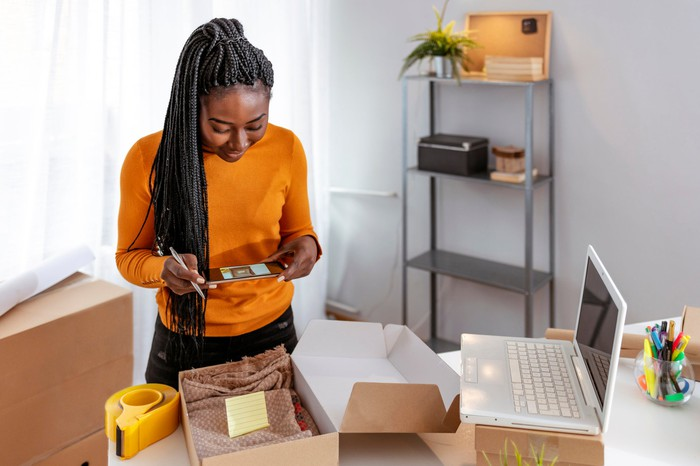 Woman boxing a package for shipment.