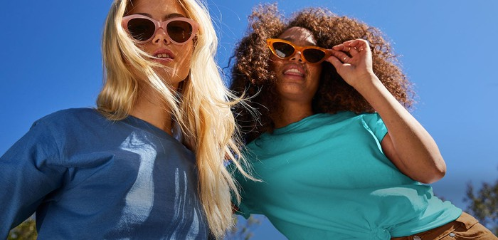 Two women wearing sunglasses and Hanes t-shirts