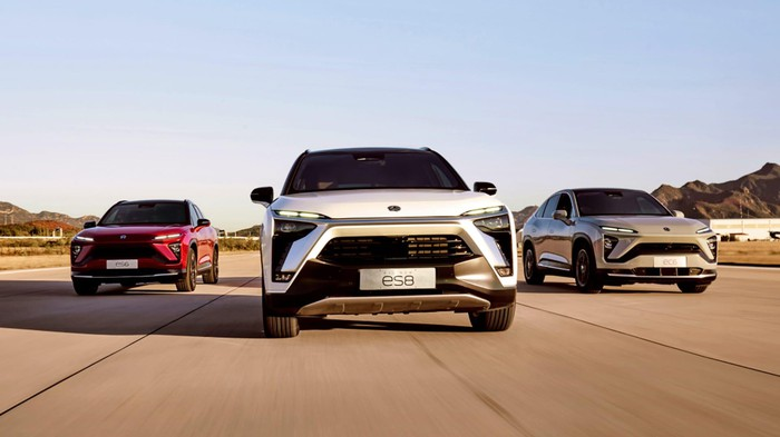 A head-on view of 3 NIO vehicles.