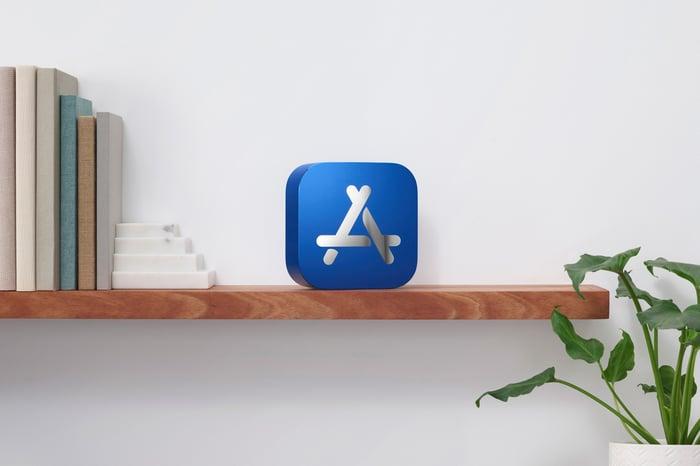 Blue box, bearing the Apple App Store logo, on a shelf.