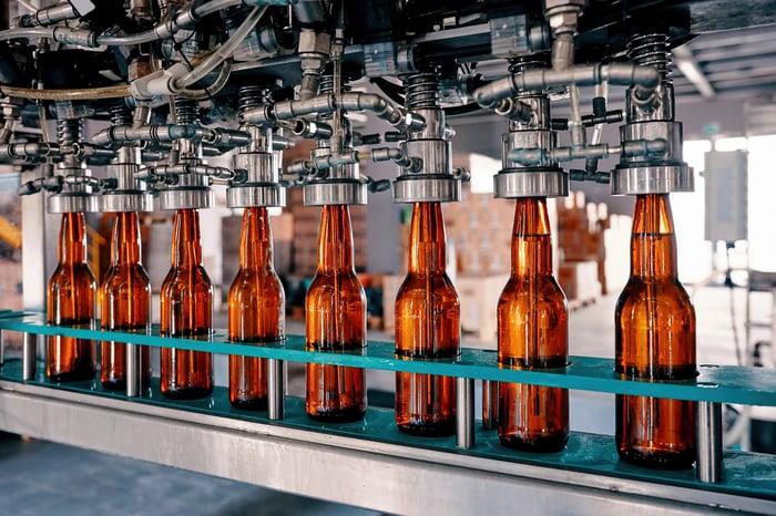 Bottles on conveyor at bottling plant