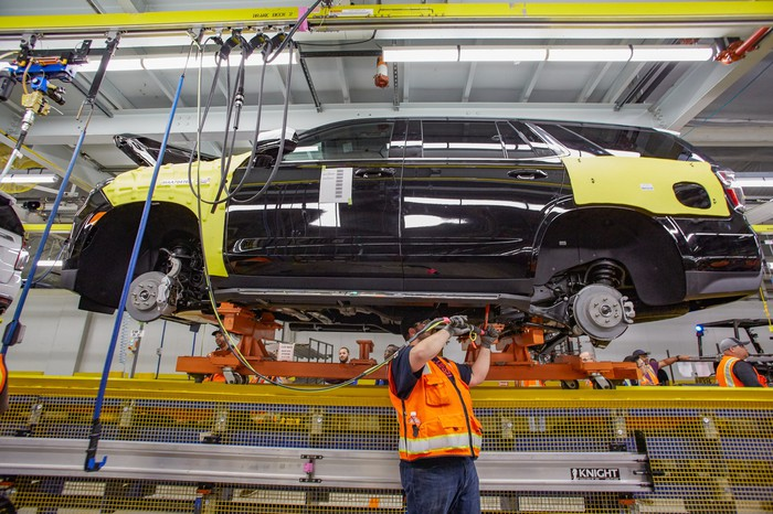 A worker tends to a 2021 Chevrolet Suburban on the assembly line at GM's plant in Arlington, Texas.
