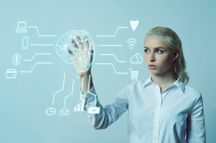 Woman interacting with digital cortex to plan an ad campaign.