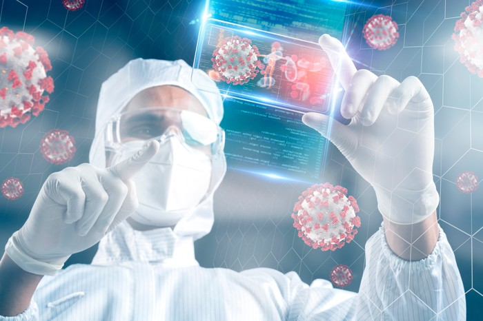 Scientist studying virus in a laboratory.