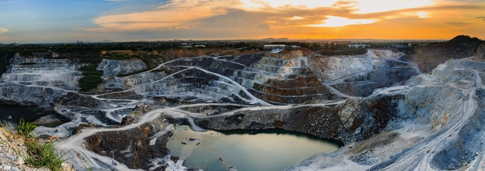 snowy open pit mine at dusk