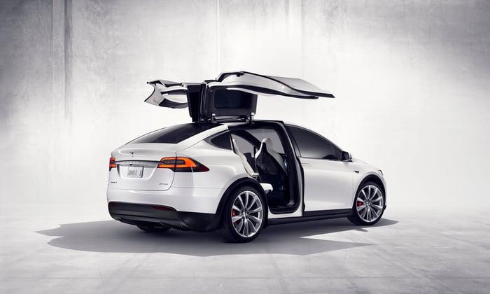 Tesla Model X with gull wings open.