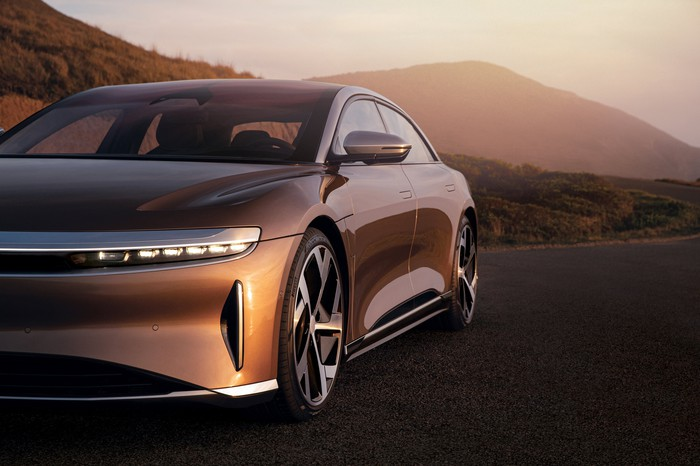 front and side view of gold Lucid Air electric luxury sedan