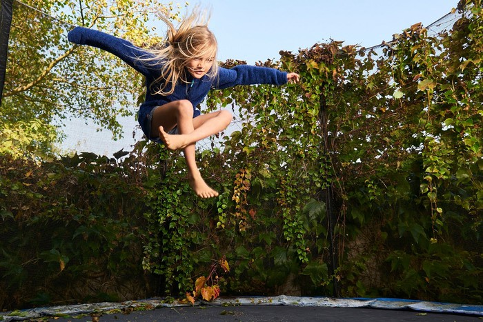 Child bouncing on a trampoline.
