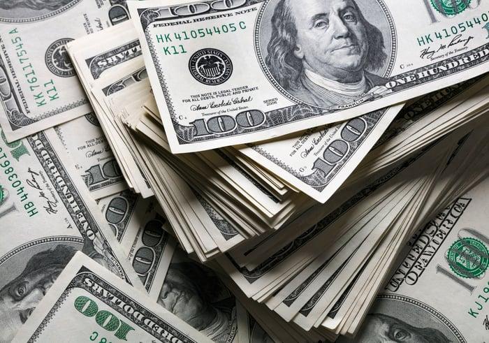 Piles of one hundred dollar bills.