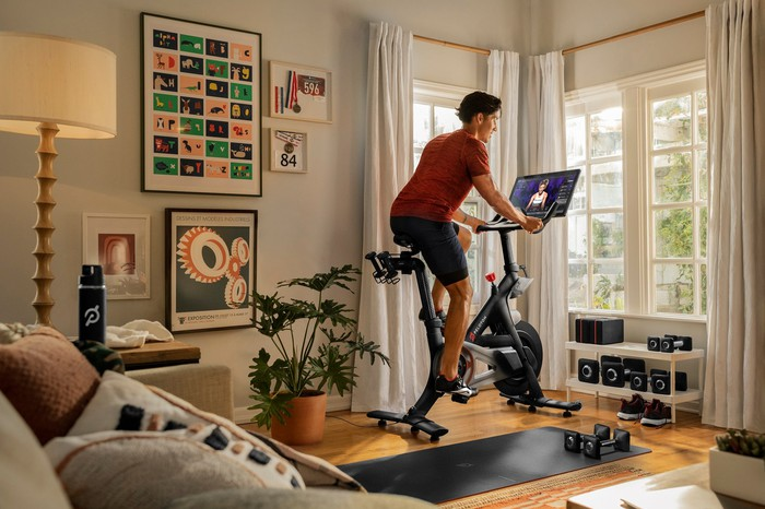 A Peloton Bike owner uses the equipment at home