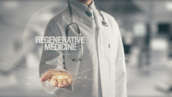 """Doctor holding hand under virtual graph art with the words """"Regenerative Medicine"""""""