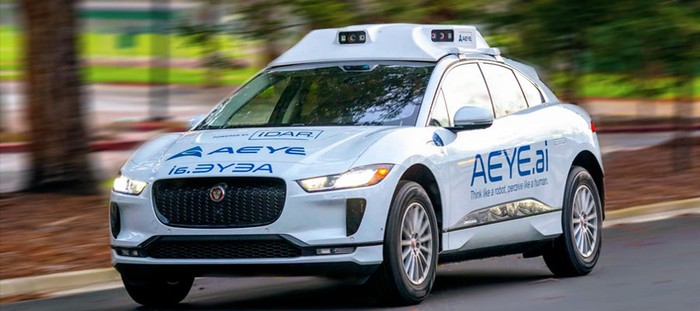 A Jaguar I-Pace SUV with rooftop sensors and AEye logos on the doors and hood.