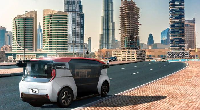 A Cruise Origin self-driving taxi van, shown on a highway entering Dubai.