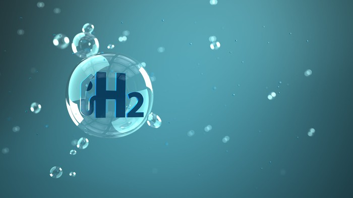 """Bubble with """"H2"""" inside floating in the air."""