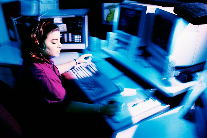woman sitting a police dispatch center