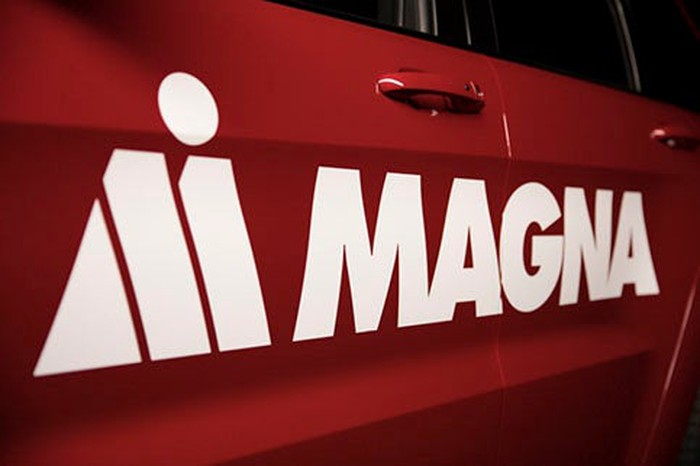 The Magna logo on a red vehicle's door.