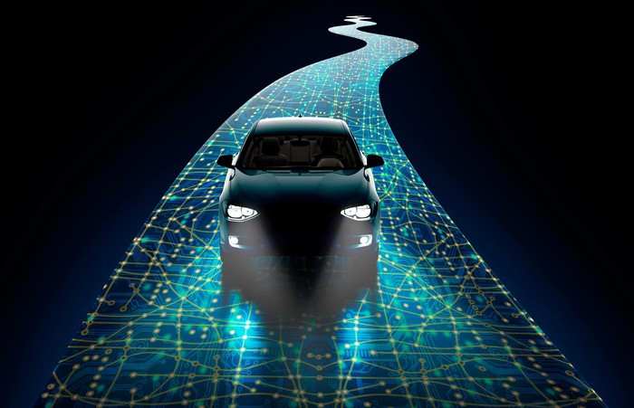 Car driving on a digitally animated road.