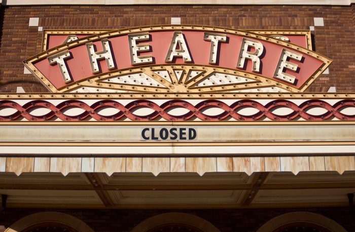 Movie theater marquee displaying a 'closed' sign.