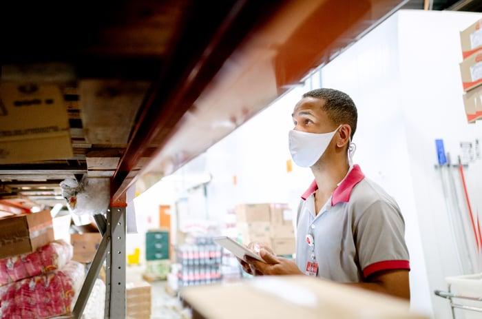 A worker in a bulk shopping warehouse.