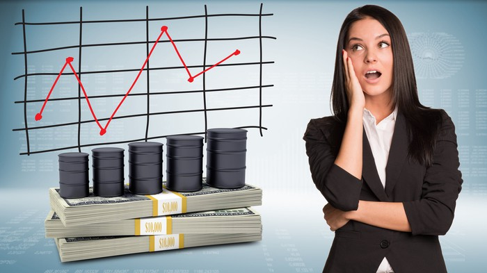 Anxious woman looking at stock chart and cash pile