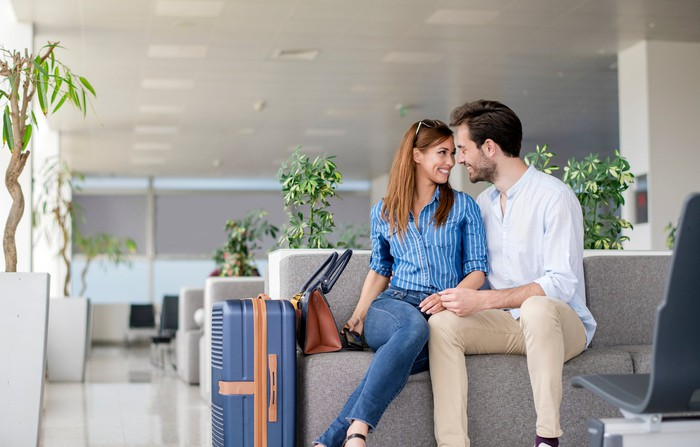 A couple in an airport.