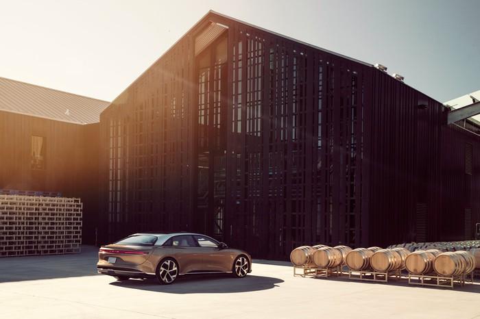 Lucid Air luxury electric sedan parked in front of building