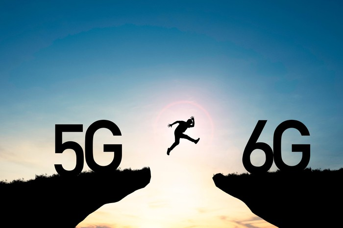Man leaping over gap between 5G and 6G
