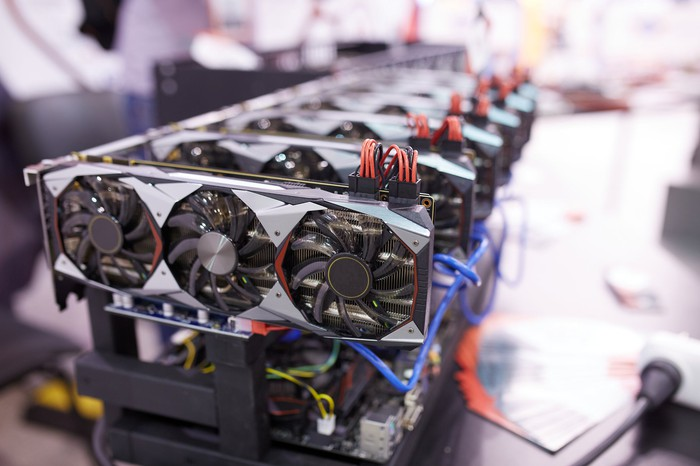 A line of GPUs plugged into a cryptocurrency mining system.