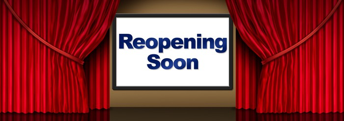 movie theater screen showing reopening soon sign