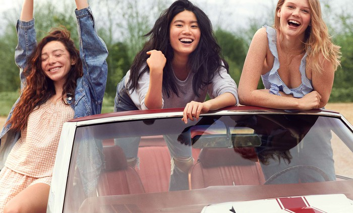 three woman standing in and around a car wearing Aerie clothing.