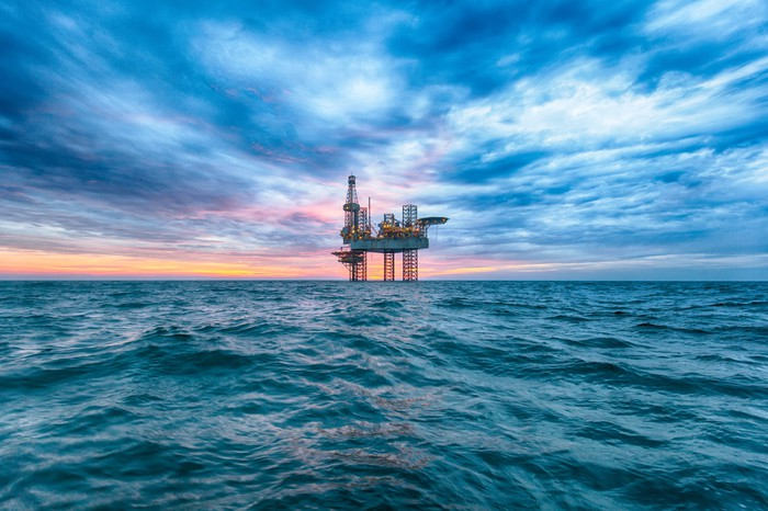 An offshore rig at dusk.