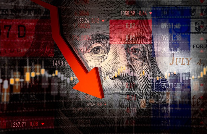 A red arrow pointing down with Benjamin Franklin's face and a stock chart in the background.