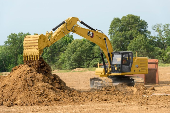A Caterpillar excavator at a construction site.