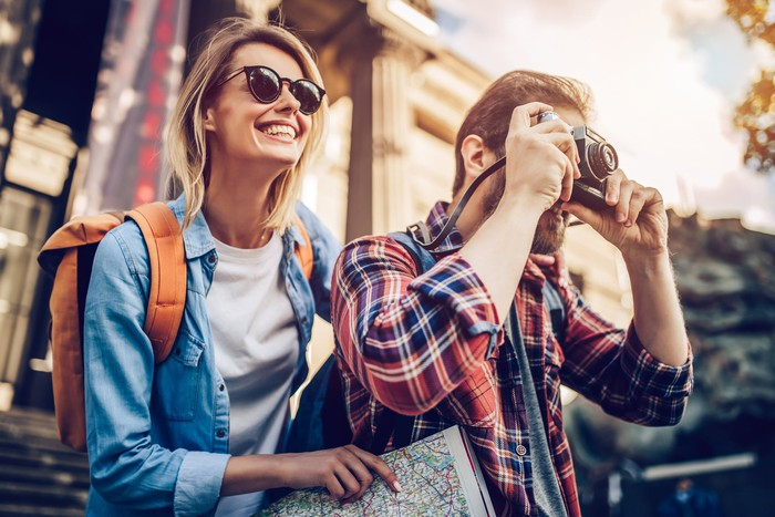 Two tourists smiling and taking pictures