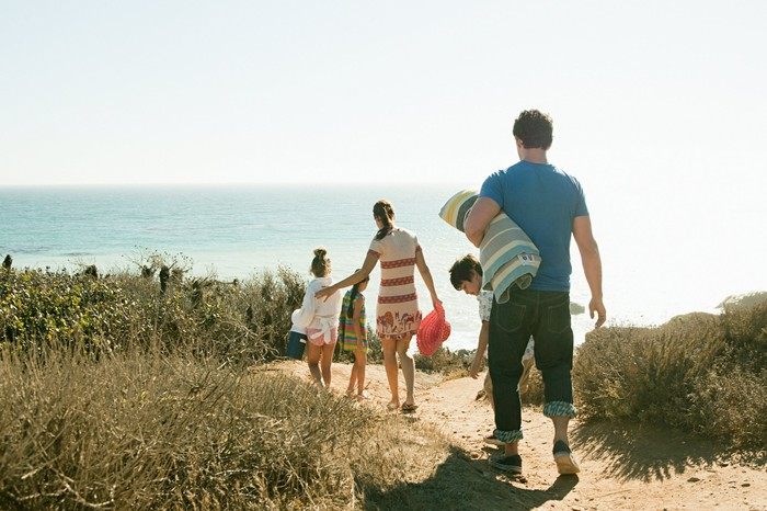 A family headed to the beach.