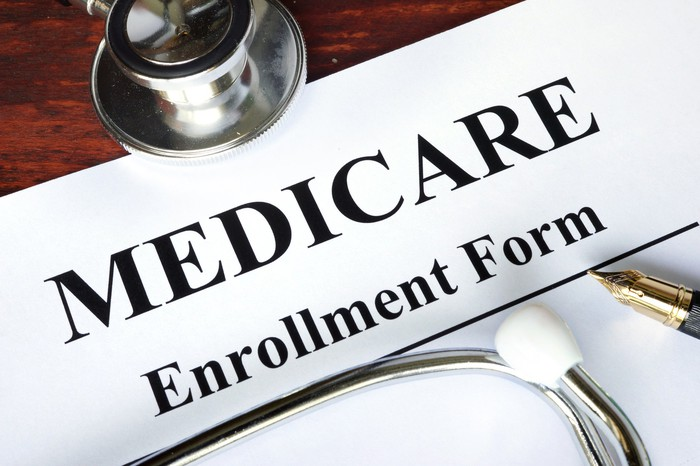 Medicare enrollment form with stethoscope resting on it