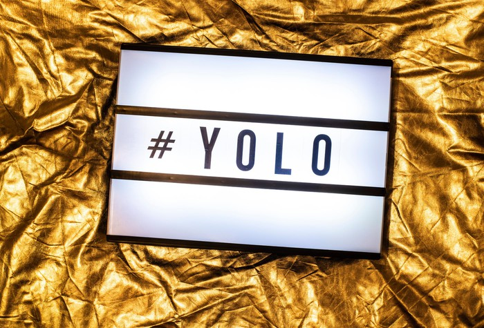 "Sign the has a hashtag and the acronym ""YOLO"""