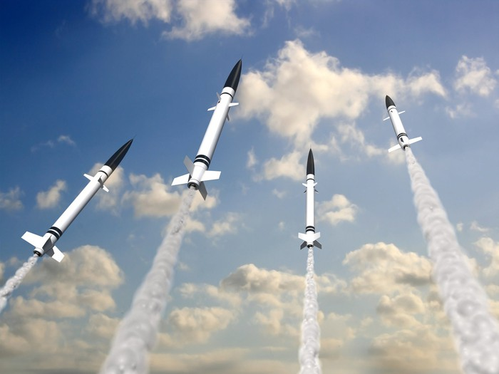 Four rockets blasting off into the sky